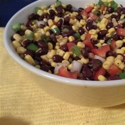 Black Bean and Corn Salad I Recipe - Beans, corn, scallions, bell peppers and onions are mixed together and napped with a vinaigrette dressing that has had a few niceties added: cilantro, pepper, cayenne and cumin. Toss and let sit overnight. Wonderful!