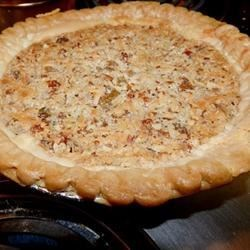 Japanese Fruit Pie Recipe -  This is a pecan pie with a fruity twist. Coconut and plump raisins are stirred into a sweet pecan pie filling and baked. Serve with vanilla ice cream or freshly whipped cream.