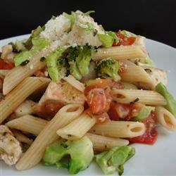 Chicken and Broccoli Pasta Recipe - Bite-sized bits of sauteed chicken meld with the fresh flavors of tomatoes and broccoli. Onion, garlic and oregano add earthy tones to the sauce. Toss with penne and a zesty handful of chopped fresh basil.