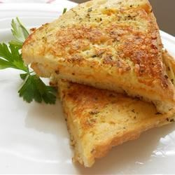 Grandma's Italian Grilled Cheese Sandwich Recipe - This is a great twist on the classic grilled cheese. Each sandwich is dipped in a savory egg coating and then pan-fried to a crispy golden brown.