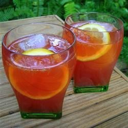 Raspberry Iced Tea Recipe - Lightly sweetened iced tea gets fruity, refreshing flavors, and a pretty pink color from fresh raspberries and lemonade mix for a perfect summer cooler.