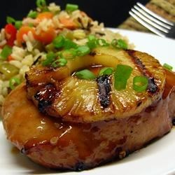 Pineapple Grilled Pork Chops Recipe - Pork chops marinate overnight in a sweet and savory Asian-inspired mixture of pineapple juice, brown sugar, and soy sauce before they're grilled and served with grilled pineapple slices.