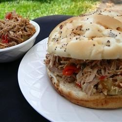 Easy Slow Cooker Pulled Pork Recipe - This pulled pork recipe uses the smokey flavor of adobo sauce and the tanginess of pepperoncini peppers to make an alternative to barbeque-style pulled pork recipes.