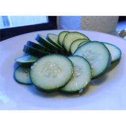 Easy Tangy Cucumber Salad Recipe - Crunchy cucumbers are tossed in a tangy and simple dressing for a light side dish to any meal.