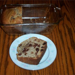 Raisin Bread I Recipe - This not-too-sweet raisin bread with a cinnamon accent is made without yeast, so you will not have to wait nearly so long to enjoy it.