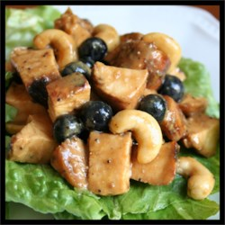 Best Chicken Salad Ever II Recipe - Grilled marinated chicken breasts are diced and tossed in a tangy, piquant sauce studded with grapes, lemon zest, poppy seeds and cashews.