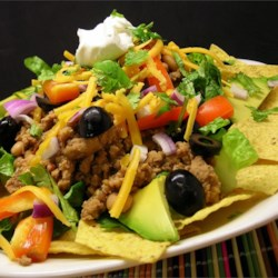 Dana's Taco Salad Recipe - Ground turkey and lentils are cooked with taco seasoning before being tossed with lettuce, avocado, tomatoes, olives and kidney beans for a delicious take on taco salad.