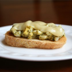 Gourmet Egg Salad Sandwich Recipe - This egg salad sandwich is loosely based on an open-faced egg salad sandwich served at a local bistro. The unexpected pairing of pesto and Jarlsberg compliments the egg salad tremendously. The amounts of each ingredient can vary depending on taste.