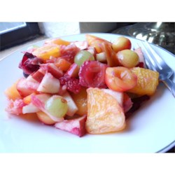 Fresh Summer Fruit Salad Recipe - Fresh fruit is tossed in homemade rhubarb sauce for a delicious, and fruity alternative to regular fruit salad!  One day I decided to stir some rhubarb sauce into my fruit salad - and LOVED the result.  The rhubarb sauce keeps fruits from turning brown too.