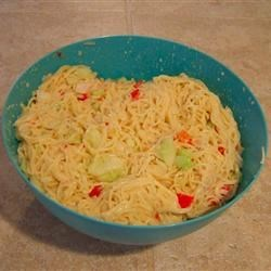 Angel Hair Pasta Salad Recipe - Delicate strands of angel hair pasta are tossed with shrimp, green onions and ranch dressing for an easy and delicious cold salad. Combining the dressing with warm pasta helps the flavors to meld. Toss in the shrimp and onions when the pasta is cooled.