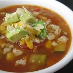 Vegetarian Tortilla Soup Recipe - Simple and delicious. It's also vegan if you don't add the cheese at the end. If you prefer a more spicy soup, add a dash or two of hot sauce before serving.