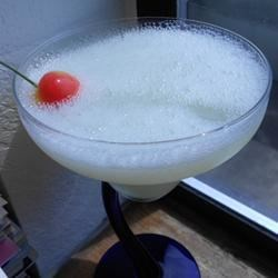My Father's Lime Daiquiri Recipe - My Father's concoction: Limes, sugar, white rum, maraschino cherries and ice cubes. Thanks, Dad!