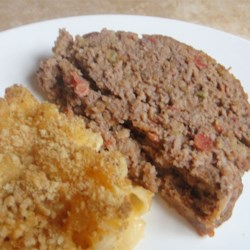 No Ordinary Meatloaf Recipe - Cornbread stuffing adds great texture and flavor to this Tex-Mex style meatloaf.