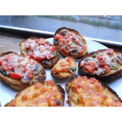 Mushroom and Tomato Bruschetta Recipe - A juicy fresh mushroom and tomato topping sets this easy bruschetta recipe apart. The cheese-topped appetizers are broiled and served warm.