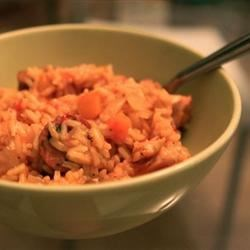 Jambalaya Recipe and Video - Chicken and andouille sausage is simmered with rice and Cajun seasonings in this spicy jambalaya recipe.