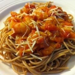 Shrimp with Spicy Tomato Sauce Recipe - A delicious and simple recipe of fresh tomatoes and shrimp that goes great over pasta - especially linguine - or rice. A nice bottle of red wine and some crusty bread, and you're all set!