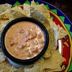 Krista's Queso Recipe - This party dip is made in the slow cooker with breakfast sausage and processed cheese.