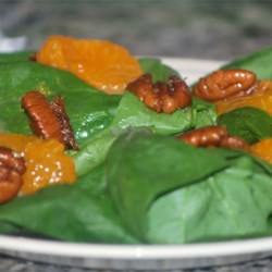 Spicy Mandarin Spinach Salad Recipe - German mustard, mandarin oranges, and Chinese five-spice powder may make this seem an exotic recipe, but you'll find it a familiar spinach and fruit salad with sweet and spicy pecans.