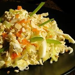 Ramen Cabbage Salad Recipe - In this salad, shredded green cabbage is tossed with dried ramen noodles and nuts in a simple sweet and sour vinaigrette.