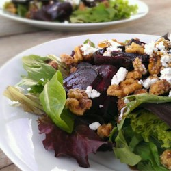 Beet Salad with Goat Cheese Recipe and Video - This is a delicious and easy salad which takes little time and is a great meatless main course. It uses beets, goat cheese, candied walnuts and baby greens.
