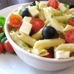 Penne, Tomato, and Mozzarella Salad Recipe - Enjoy the bright, fresh flavors of tomato and basil in this quick and easy dish. Toss hot pasta with sauteed garlic and scallions; add chopped tomatoes, mozzarella, Parmesan, basil and olives.