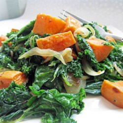 Roasted Yam and Kale Salad Recipe - A bright contrast in flavors makes this salad a favorite among friends and family. The yams have a subtle sweetness that pairs nicely with the caramelized onions and kale.
