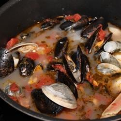 Cioppino Recipe and Video - A classic seafood stew with a little bit of everything from the sea. Shrimp, scallops, clams, mussels, and crab meat; seasoned with oregano, thyme and basil. Serve with a loaf of warm, crusty bread for sopping up the delicious broth!
