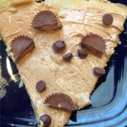 Peanut Butter Cup Dessert Pizza Recipe - Prepared cookie dough is topped with peanut butter cups and chocolate chips for a dessert pizza any fan of peanut butter cups will love.