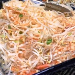 Okinawan-Style Pad Thai Recipe - This chicken Pad Thai dish of rice noodles and scrambled eggs adds sugar and unsalted peanuts for a Japanese twist on the popular Thai menu item.
