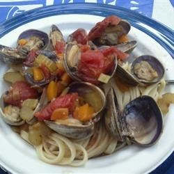 Clams Creole Recipe - Clams are steamed with tomatoes, chilies and wine in this fast and easy dish. Serve over linguine with crusty bread to sop up the juice!