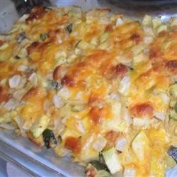 Cheesy Zucchini Casserole I Recipe - Zucchini baked with bread cubes, onion and garlic, and topped with cheese.