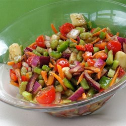 Garden Delight Recipe - All the ingredients in this salad are shredded or diced, so when the zesty balsamic vinaigrette is drizzled on, every tiny morsel of salad is coated and glistening with flavor. Chill and serve to six.