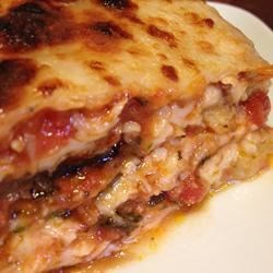 Jewish Eggplant Lasagna Recipe - This eggplant lasagna replaces noodle layers with eggplant slices breaded with matzo meal. It has a rich layer of mushrooms and red peppers and is topped with fresh mozzarella cheese slices.