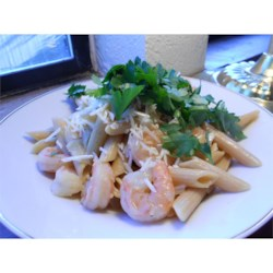 Cissy's Shrimp Penne Recipe - Shrimp, Parmesan cheese, and parsley are tossed with penne pasta in a delicious wine and vermouth reduction.