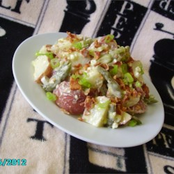 Blue Cheese and Bacon Potato Salad Recipe - Red potatoes are combined with blue cheese, crispy bacon, and green beans, creating a creamy and flavorful potato salad everyone will enjoy.
