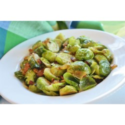 Brussels Sprouts ala Angela Recipe - Brussels sprouts are steamed in stock with pan-fried bacon, onion, and garlic in this tasty side dish.