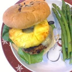Five Spice Turkey Cheeseburgers Recipe - Grilled pineapple, ginger, and Asian five-spice seasoning lend an almost Hawaiian quality to these delicious burgers topped with gouda cheese. They use turkey as an alternative to ground beef.