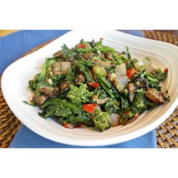 Broccoli Rabe with Portobello Mushroom Recipe - Steamed broccoli rabe (rapini) is tossed with slow cooked portobello mushrooms, garlic, and Parmesan cheese in this flavorful side dish.