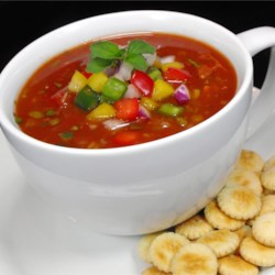 Lucky's Gazpacho Recipe - A wonderful cold savory soup made with tomatoes, cucumber, green and red bell peppers, and seasonings won't heat up the kitchen on those hot summer days. Garnish with fresh parsley, chives, dollops of sour cream, and toast.