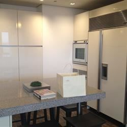 fridge and microwave on the side