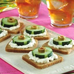 Cucumber and Olive Appetizers Recipe - A classic little hors d 'oeuvres, these crunchy rounds rely on rye bread for their sturdy base; a cream cheese/blue cheese spread holds it all together.