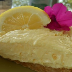 Lemonade Pie I Recipe - Lemonade concentrate is stirred into lemon pudding and then combined with whipped topping. This creamy lemon filling is poured into a graham cracker crust, decorated with lemon slices, and chilled.