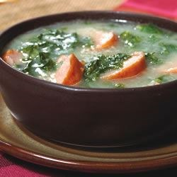 Kielbasa Kale Stew Recipe - A thick stew with a rich potato base, fresh kale, and slices of savory kielbasa. This is a meal all by itself.