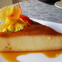Flan Mexicano (Mexican Flan) Recipe - A creamy, rich, orange-scented custard displays a golden syrupy topping of caramelized sugar in this classic Mexican dessert. It's been a treasured family secret for years.