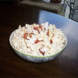 Real Bacon Popcorn  Recipe - Popcorn gets a savory, smoky taste from lots of crisp real bacon bits cooked right in.