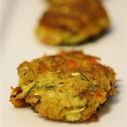 Zucchini Cakes Recipe - This recipe is a vegetarian version of crab cakes. The zucchini keeps the cakes moist, while the seafood seasoning and bread crumbs give it that crab cake feel and taste.