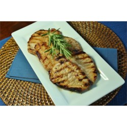 Andrew's Favorite Grilled Pork Chops Recipe - Start these thick grilled pork chops ahead of time, marinating in the simple but flavorful mixture of orange juice and soy sauce with green onions. Then making dinner will take just a few minutes.
