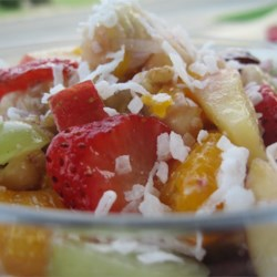 Ann's Fantastic Fruit Salad Recipe - This colorful and citrus-y fruit salad has a hint of shredded coconut and walnuts for a refreshing tropical salad.