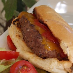 All-American Burger Dog Recipe - The tastiness of a burger in the shape of a hot dog makes the burger dog the best of both worlds for your next summer cookout.