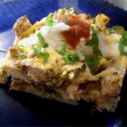 Tortilla Zucchini Casserole Recipe - Zucchini, bell pepper, and onion are layered between corn tortillas and sour cream in this cheesy and comforting casserole.